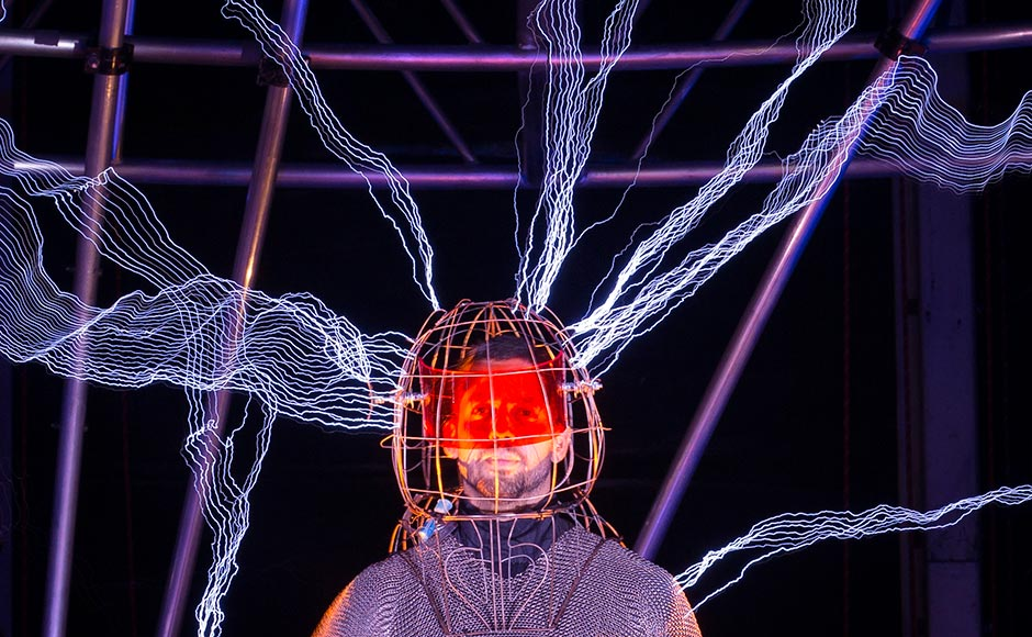 "Magician David Blaine stands inside an apparatus surrounded by a million volts of electric currents streamed by tesla coils during his 72-hour ""Electrified: 1 Million Volts Always On"" stunt on Pier 54, New York. John Minchillo/AP"