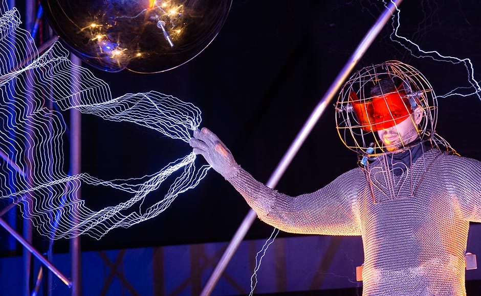 "Millions of volts of electric currents streamed through Blaine's fingertips via tesla coils during his 72-hour ""Electrified: 1 Million Volts Always On"" stunt in New York. John Minchillo/AP"