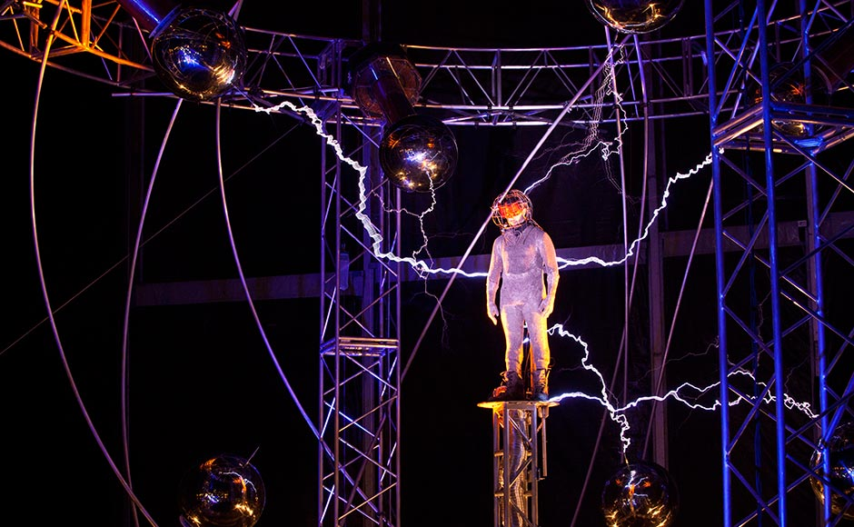 Magician David Blaine channels bolts of electricity from various tesla coils charged with one million volts of electricity during a stunt on Pier 54 in New York. Andrew Burton/Reuters