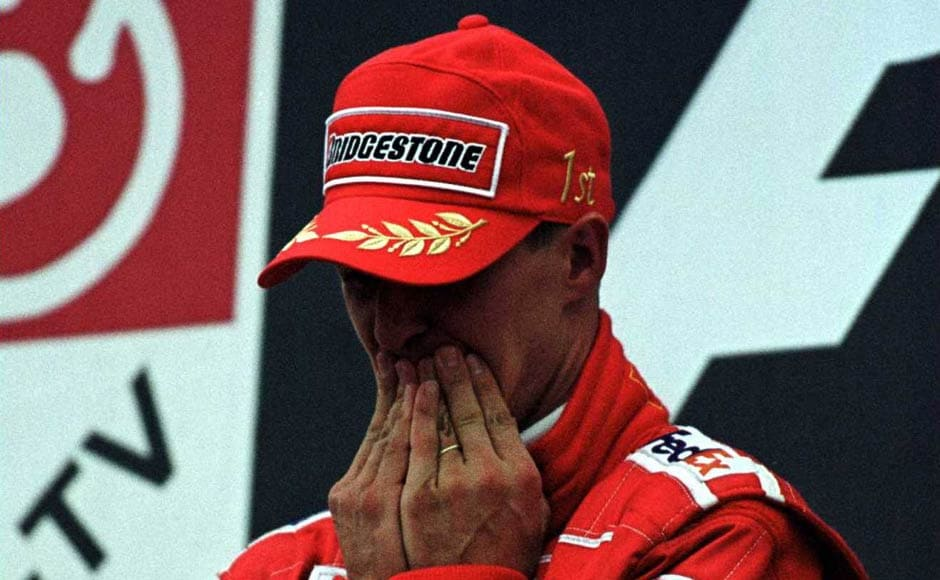 This picture is iconic for how Schumacher broke into tears after winning his 3rd world title and equaling Ayrton Senna's record of 41 wins. It is a moment which catapulted him as probably the best F1 driver ever. Getty Images