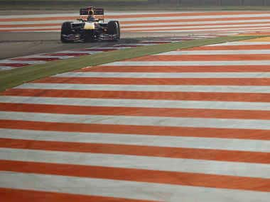 File picture of Red Bull Formula One driver Vettel drives during the Indian first F1 Grand Prix. Reuters