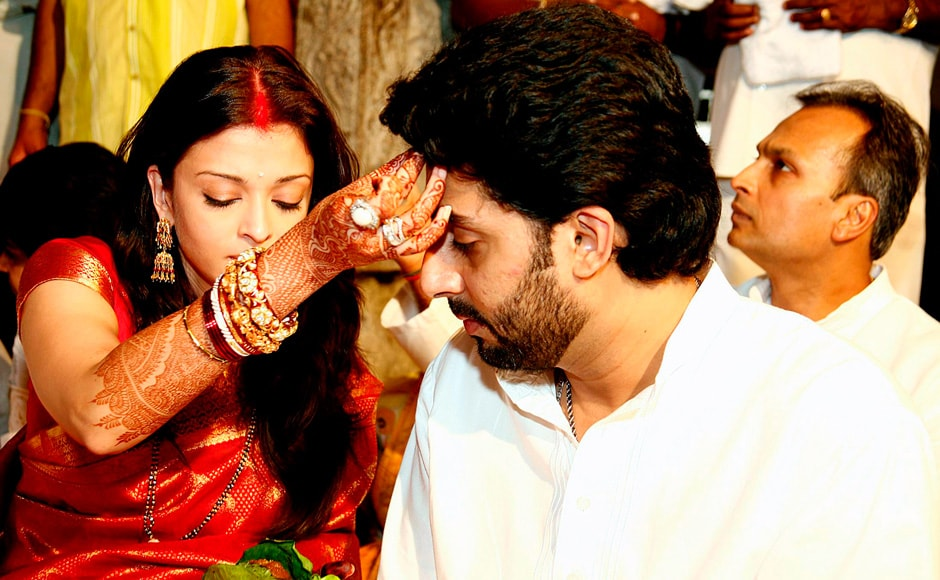 Bollywood actress Aishwarya Rai with her husband actor Abhishek Bachchan, a few days after her wedding, perform prayers at Tirumala Tirupati Devasthanam temple shrine in Tirumala, 750 km (471 miles) south of Hyderabad, 22 April 2007.  Reuters