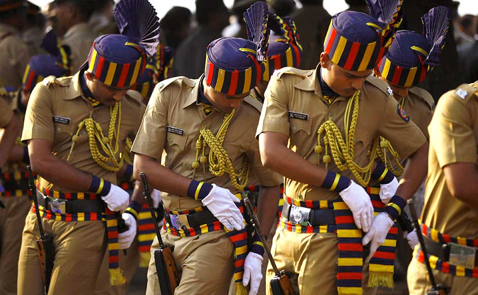 Policemen keep their weapons as they pay tribute at the memorial to the victims of the 26/11 Mumbai terror attacks during an event in the city on the fourth anniversary of the attacks. AP