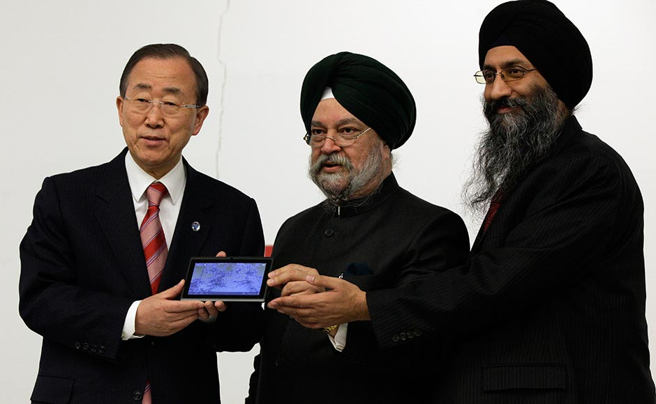(You sure this isn't made in China?) UN Secretary General Ban Ki-moon shows off the Aakash 2 along with Datawind CEO Sunit Singh Tuli.India's UN Ambassador Hardeep Singh Puri is also present. Richard Drew/AP
