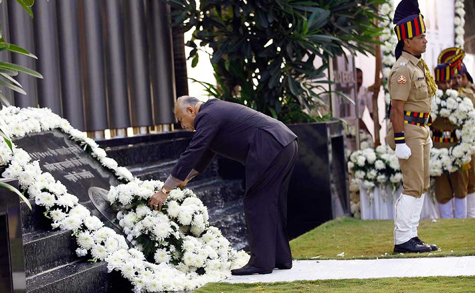 Home Minister Sushil Kumar Shinde offers a floral wreath at the memorial commemorating the victims of the Mumbai terror attacks on its fourth anniversary in Mumbai. AP