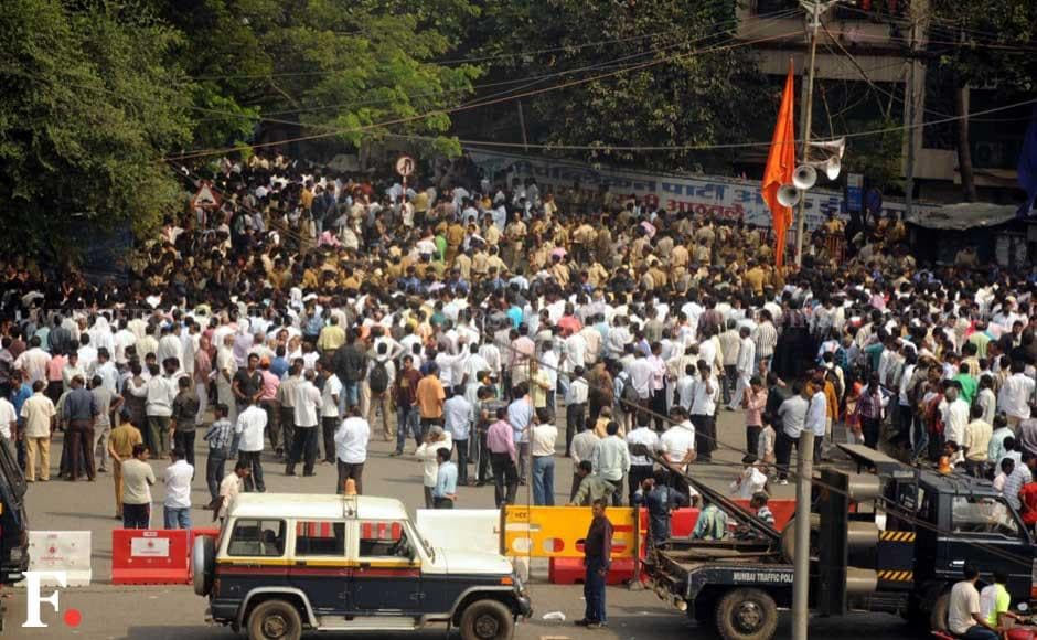 Crowds of Shiv Sena activists gather outside the Thackerays' residence in suburban Mumbai. Sachin Gokhale/ Firstpost