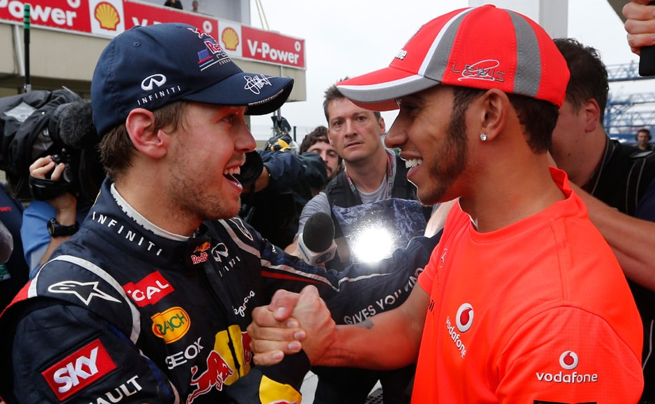 McLaren Formula One driver Lewis Hamilton of Britain (R) with Red Bull driver Sebastian Vettel of Germany after the Brazilian F1 Grand Prix at Interlagos circuit in Sao Paulo. Vettel became Formula One's youngest triple world champion at the age of 25 at the Brazilian Grand Prix on Sunday. Reuters