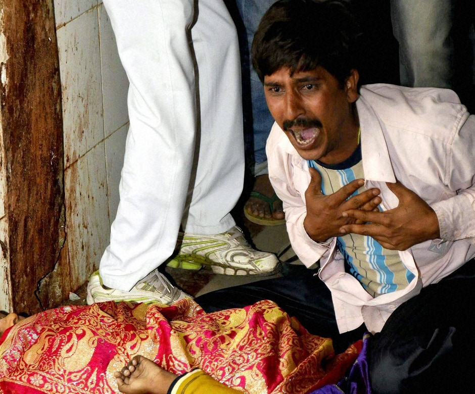 A man mourns the death of a relative in Patna. PTI