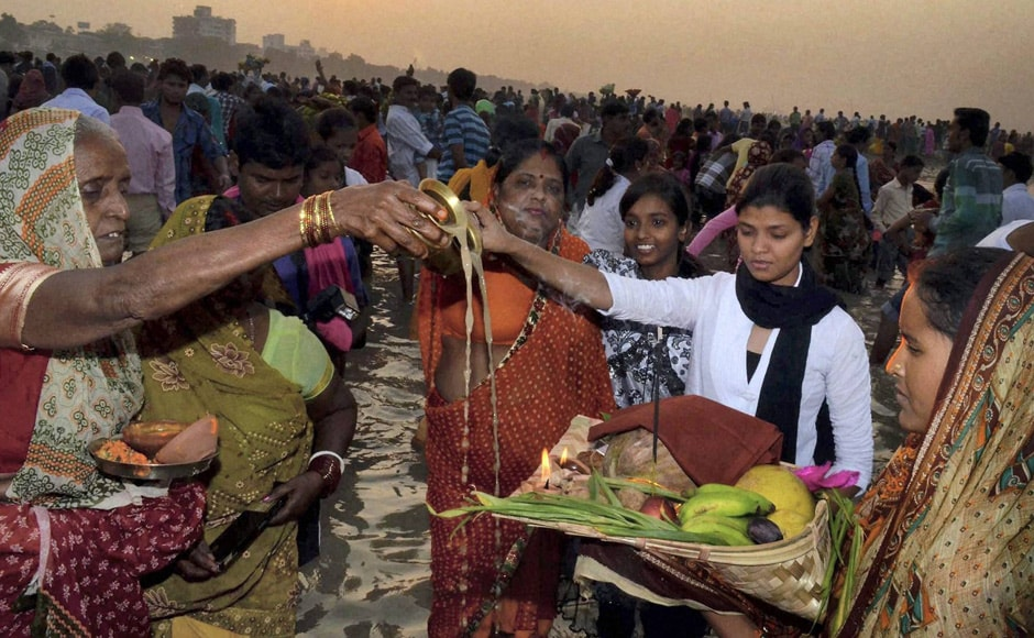 Devotees offer prayers to Lord Sun during Chhat Puja at the Ganga river in Patna. PTI