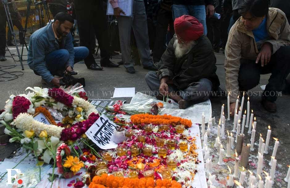 Protesters in Jantar Mantar light candles for the 23-year-old girl who died on Saturday. Naresh Sharma/Firstpost