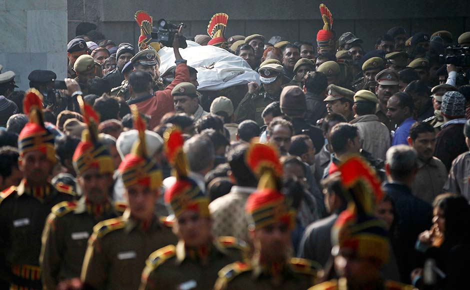 The body of constable Subhash Tomar is brought for cremation in New Delhi. Tomar was injured in Sunday's clashes with people protesting against the brutal gang-rape of a woman on a moving bus died in hospital.Mustafa Quraishi/AP