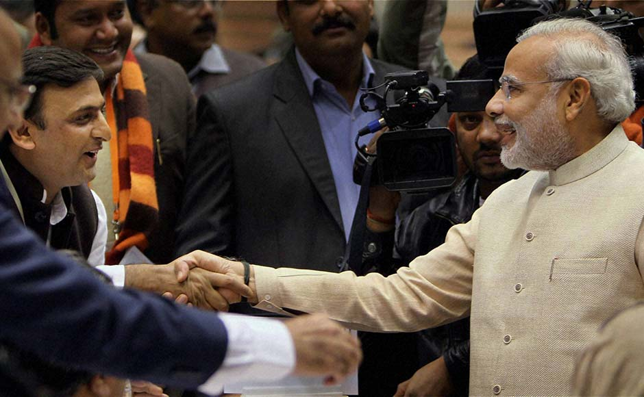 Gujarat Chief Minister Narendra Modi shakes hands with UP Chief Minister Akhilesh Yadav during the 57th National Development Council (NDC) meeting in New Delhi.PTI