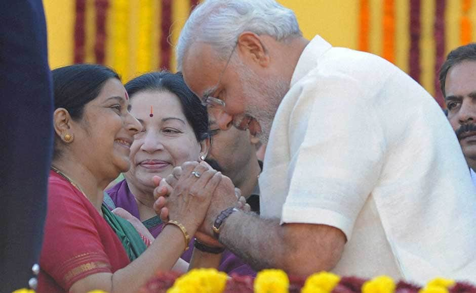 Gujarat Chief Minister Narendra Modi exchanges greetings with senior BJP leader Sushma Swaraj during his swearing-in ceremony at Sardar Patel Stadium in Ahmedabad. PTI