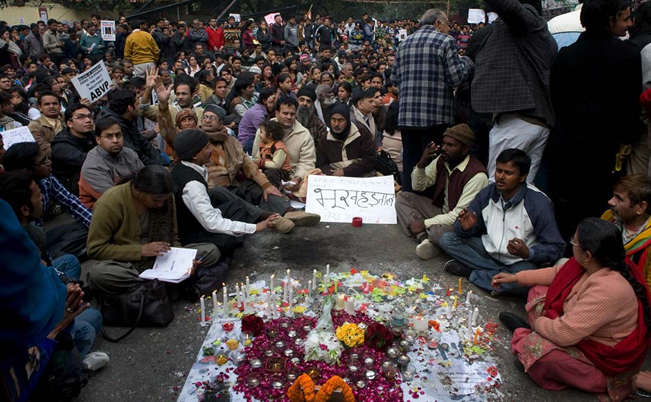 Protestors at Jantar Mantar offer prayers for the Delhi gangrape victim who died on Saturday due to the grievous injuries she suffered in the attack. Naresh Sharma/Firstpost