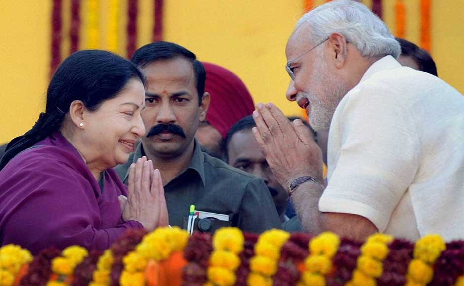 Gujarat Chief Minister Narendra Modi greets Tamil Nadu Chief Minister J Jayalalithaa during his oath taking ceremony at Sardar Patel Stadium in Ahmedabad. PTI