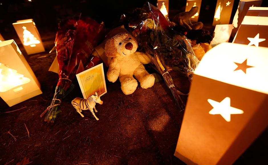 Candles surround gifts and flowers that were left in honour of the victims of the mass shooting at Sandy Hook elementary school.Jared Wickerham/Getty Images