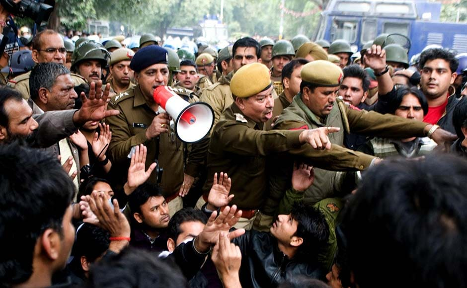 Delhi police try and control the crowd that tried to break barricades. Naresh Sharma/Firstpost