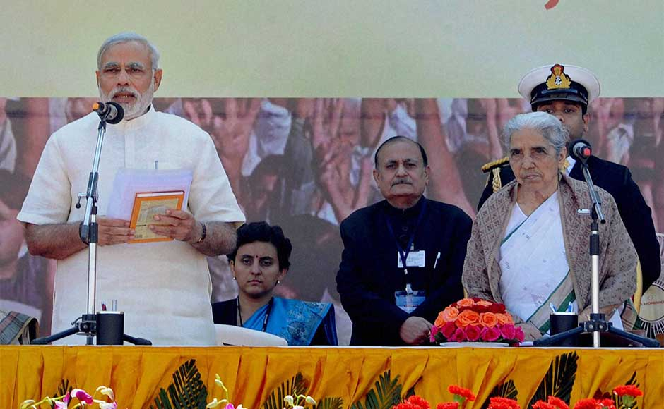 Narendra Modi taking oath as Gujarat's Chief Minister for the fourth time at a grand function at Sardar Patel Stadium in Ahmedabad on Wednesday. Gujarat Governor Kamla Beniwal is seen on the right.PTI