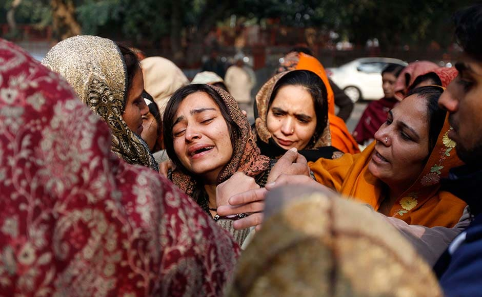 Relatives of policeman Subhash Tomar grieve as his body is brought for cremation in New Delhi.Mustafa Quraishi/AP