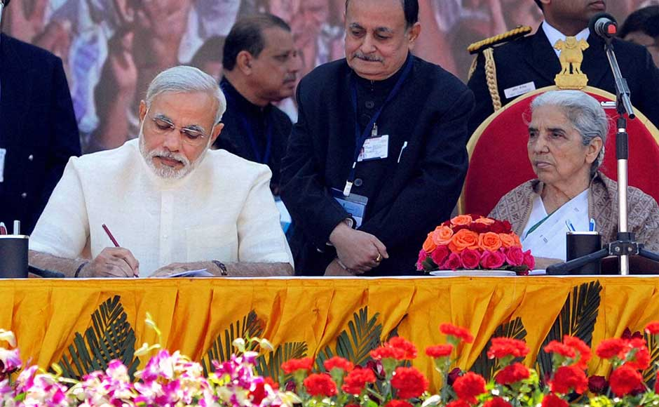 Gujarat Governor Kamla Beniwal (right) and Chief Minister Narendra Modi at the latter's swearing-in ceremony at Sardar Patel Stadium in Ahmedabad. PTI