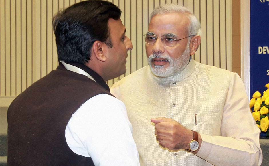 Gujarat Chief Minister Narendra Modi and UP CM Akhilesh Yadav during the 57th National Development Council (NDC) meeting in New Delhi .PTI