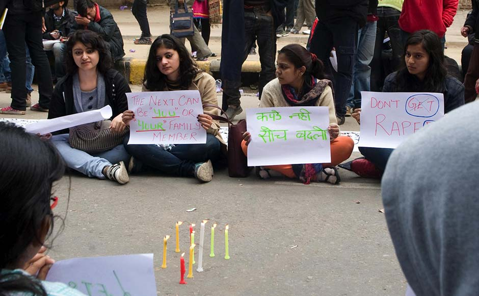 Protestors hold posters demanding justice for the Delhi gangrape victim. Naresh Sharma/Firstpost