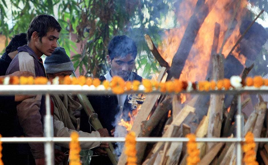 Cremation of police constable Subhash Chand Tomar being performed in New Delhi.PTI