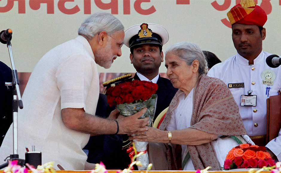 Gujarat Governor Kamla Beniwal greets BJP leader Narendra Modi after he took oath as the Chief Minister of the state for the fourth time at Sardar Patel Stadium in Ahmedabad. PTI