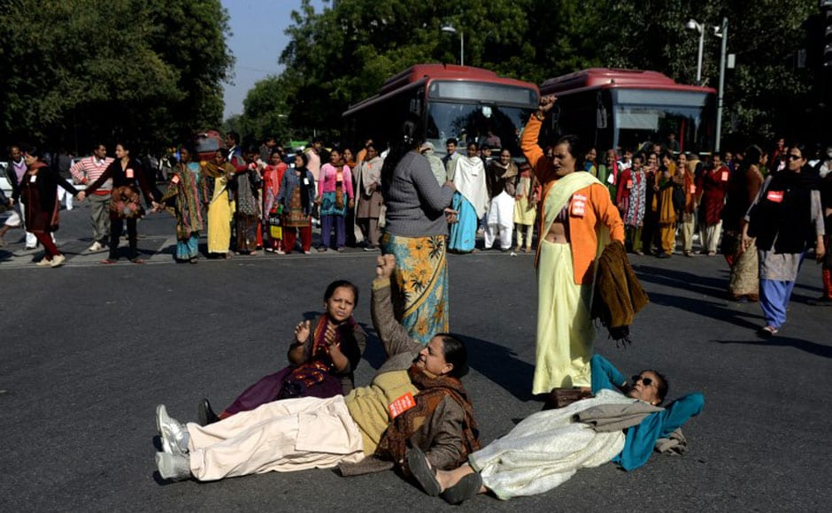 Activists lie on the road in New Delhi on Tuesday as a mark of protest against the gangrape. The incident has sparked fresh concern for women's safety in the city which is now being termed as the rape capital of India. AFP