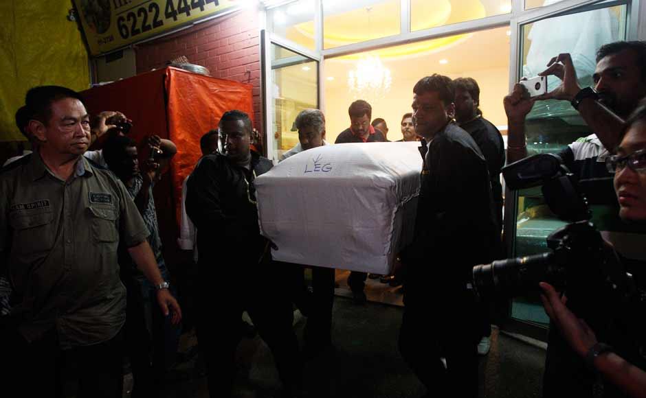 The body of the Delhi gangrape victim being brought out of the funeral parlour after it was embalmed. Reuters