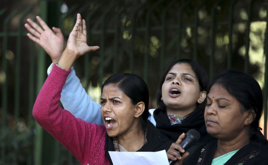 Women activists shout slogans demanding safety for women as they stage a protest in New Delhi on Tuesday. AP
