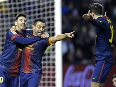 Barcelona's Xavi Hernandez, Lionel Messi, and Jordi Alba celebrate a goal during their Spanish First Division soccer match against Real Valladolid at Zorrilla Stadium in Valladolid. Reuters