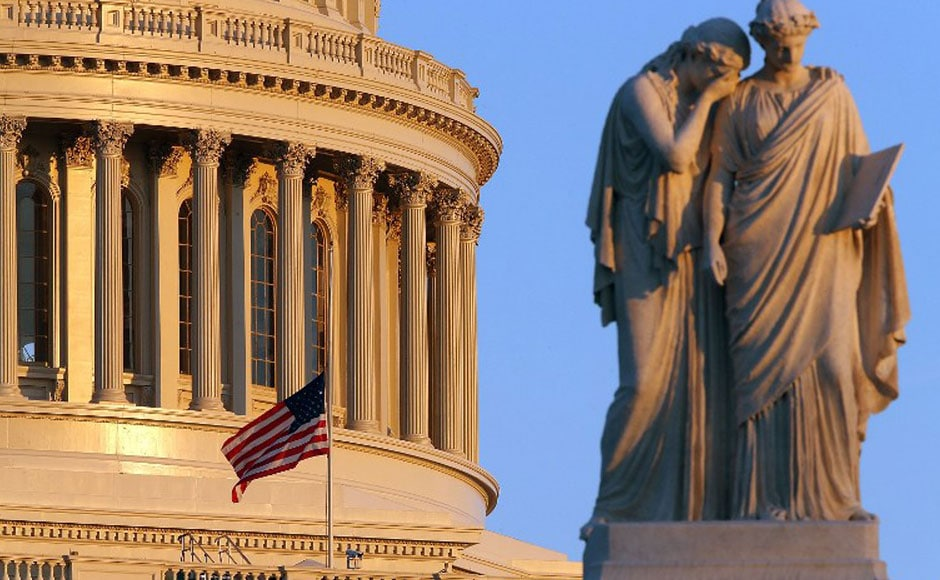 The US flag on half mast in the US capitol in commemoration of the victims of one of the tragic chapters in US history. AFP