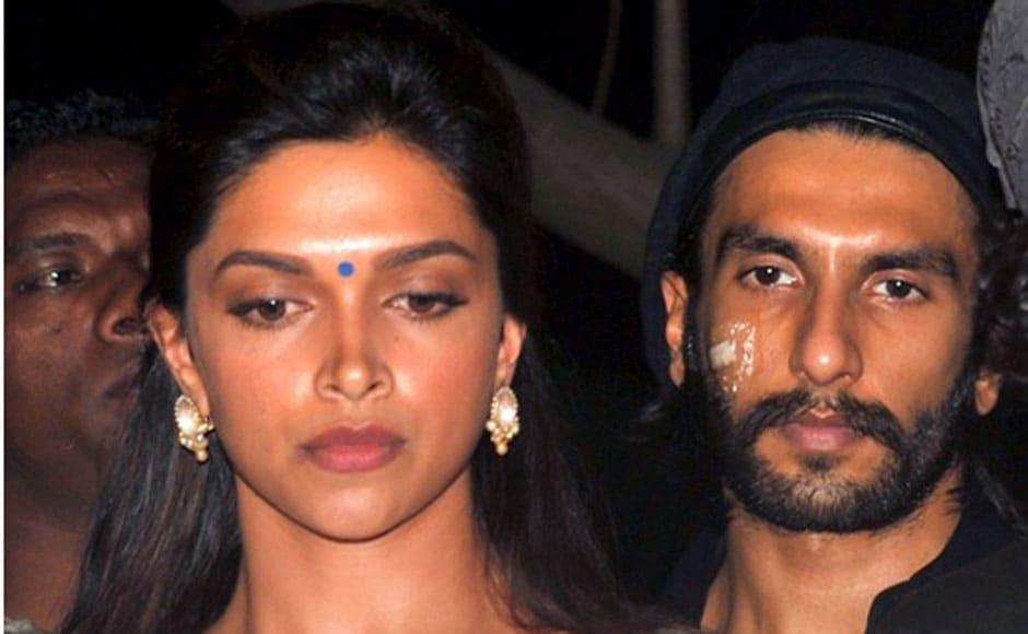 Actors Deepika Padukone and Ranveer Singh at the candle light vigil in Juhu. AFP