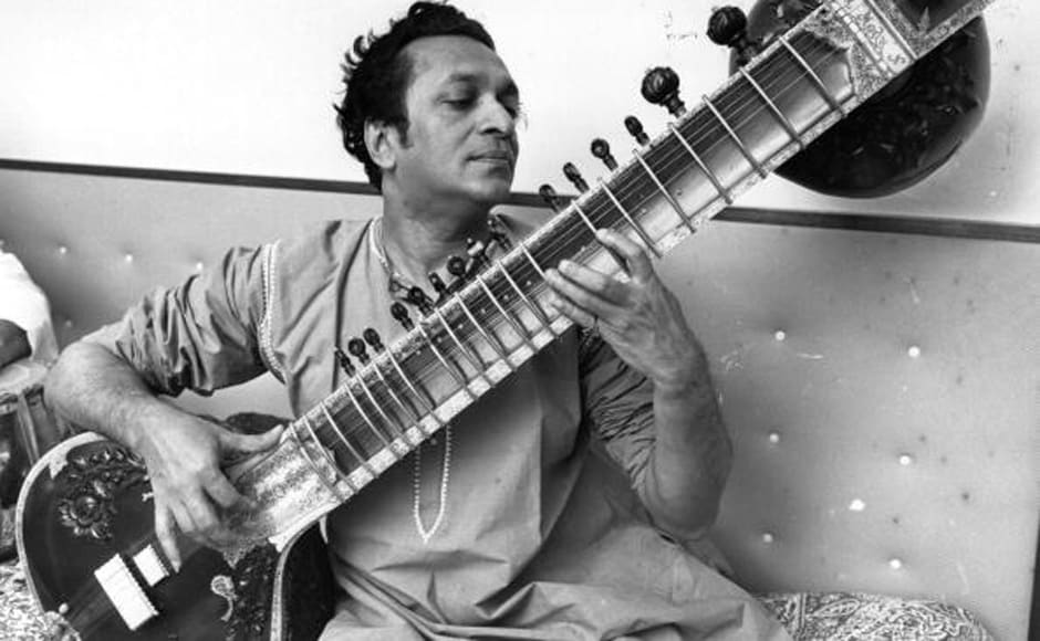 Ravi Shankar, the Indian composer and sitar player pictured playing his sitar on 31 May, 1966. Getty Images