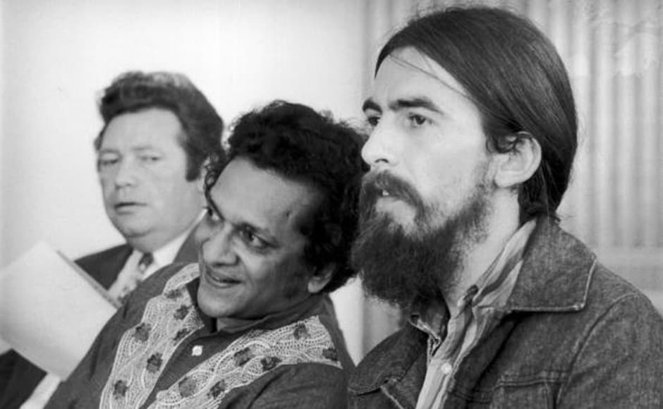 Singer-songwriter George Harrison, former member of The Beatles, at the Royal Festival Hall with Indian sitar maestro Ravi Shankar. Getty Images