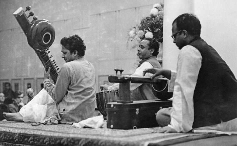 Indian musician and composer Ravi Shankar (left) playing a sitar in a concert with tabla player Alla Rakha and tanpura player Prodyot Sen, 15th October 1958. Erich Auerbach/Hulton Archive/Getty Images