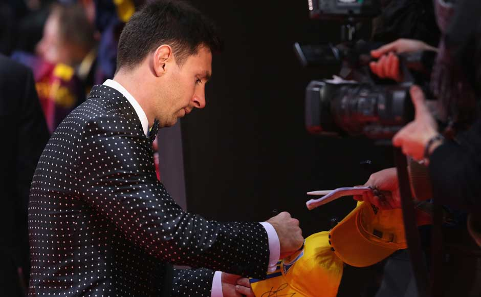 Messi was humble enough to stop for autographs before the announcement. Getty Images