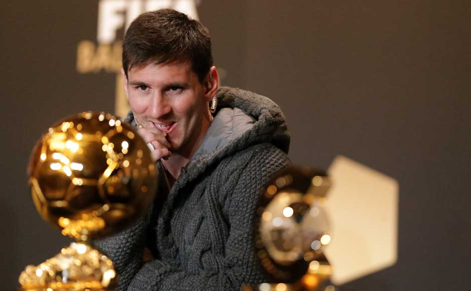 I know it's mine: Prior to the ceremony, Messi eyes the award at a press conference. Getty Images