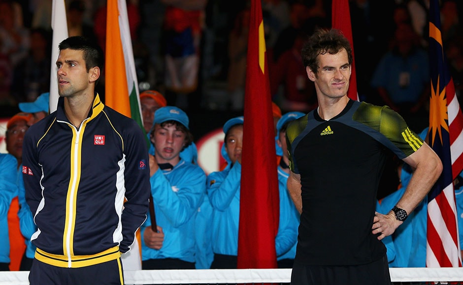 Champion Novak Djokovic and runner up Andy Murray wait for the presentation ceremony after their men's final match. Michael Dodge/Getty Images