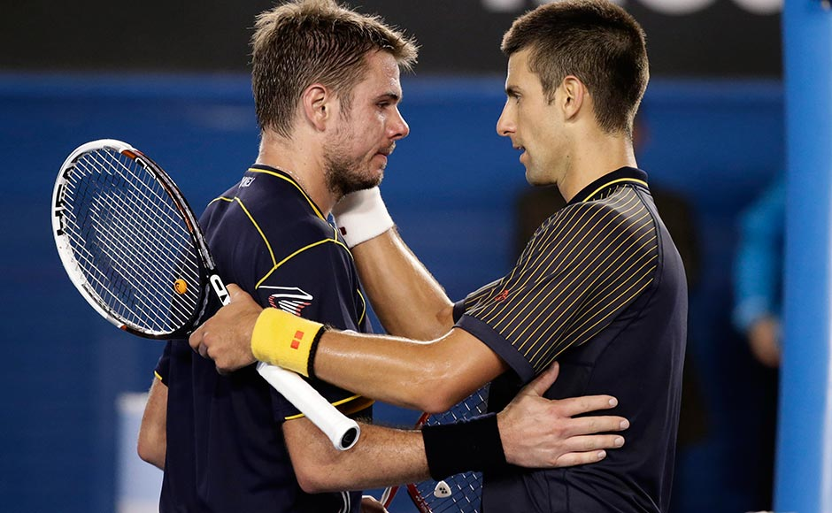 Serbia's Novak Djokovic, right, embraces Switzerland's Stanislas Wawrinka after winning their fourth round match at the Australian Open tennis championship in Melbourne. Andy Wong/AP
