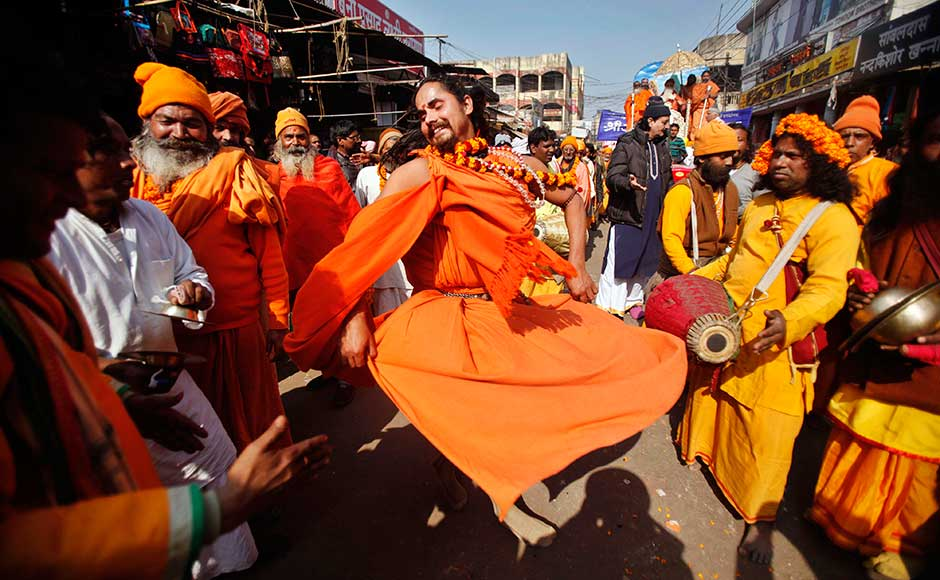 A Sadhu dances to the beats of drums during a religious procession towards the Sangam during the Maha Kumbh mela in Allahabad. Rajesh Kumar Singh/AP