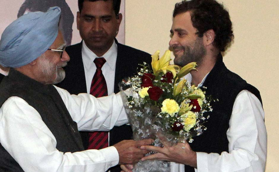 n Prime Minister Manmohan Singh, left, greets Rahul Gandhi after he was appointed Vice President of the Congress party, in Jaipur. AP