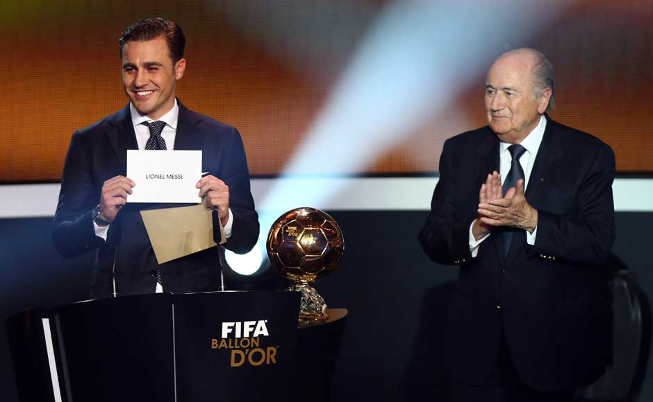 "Former World Player of the Year Fabio Cannavaro and FIFA president Sepp Blatter pick out the winner's name. No opportunity to say, ""Surprise!"". Getty Images"