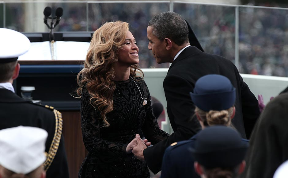 :  U.S. President Barack Obama greets singer Beyonce after she performs the National Anthem during the public ceremonial inauguration on the West Front of the US Capitol.  Win McNamee/ Getty Images