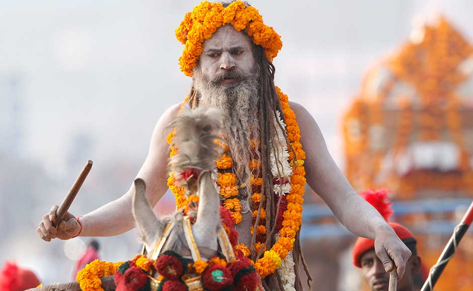 A Naga Sadhu participate in a religious procession towards the Sangam, the confluence of rivers Ganges, Yamuna and mythical Saraswati, as part of the Maha Kumbh festival in Allahabad. Rajesh Kumar Singh/AP