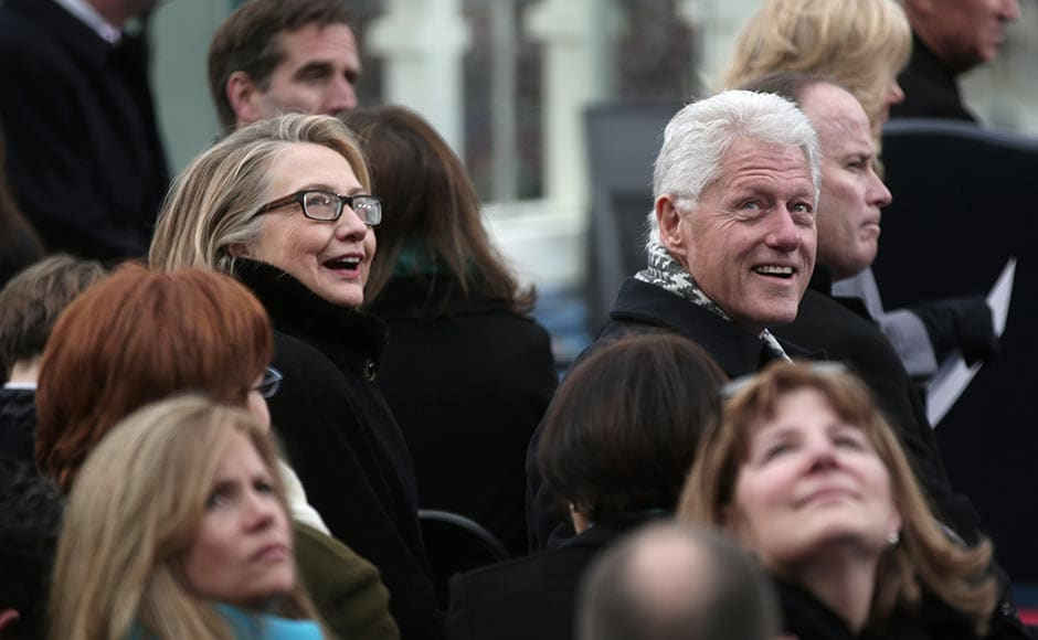 Secretary of State Hillary Clinton and former president Bill Clinton look on during the public ceremonial inauguration on the West Front of the US Capitol. Win McNamee/Getty Images