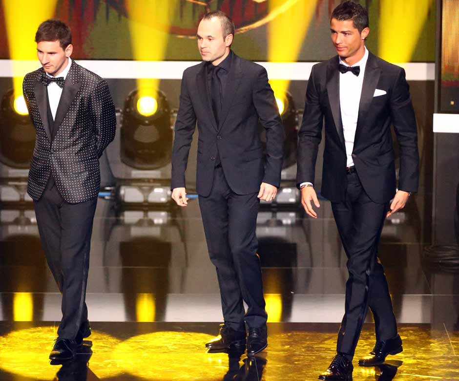 The world's top three players await the announcement. Messi stood first, followed by Ronaldo and Iniesta. Getty Images