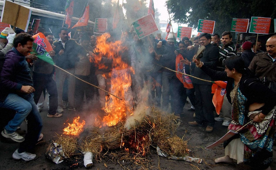 BJP workers burn an effigy of Union Home Minister Sushil Kumar Shinde in Lucknow during a protest over his controversial remarks on Thursday. PTI
