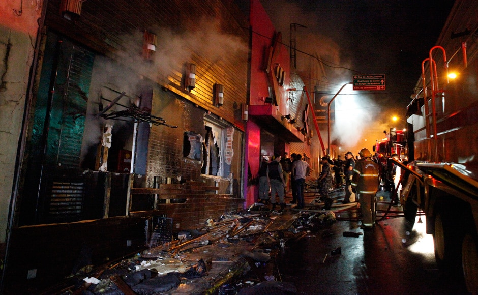 Firefighters work to douse a fire at the Kiss Club in Santa Maria city, Rio Grande do Sul state, Brazil, Sunday, Jan 27, 2013. AP